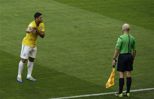 ASSOCIATED PRESSBrazil's Hulk argues with the assistant referee after his goal was disallowed due to a handball during the World Cup round of 16 soccer match between Brazil and Chile at the Mineirao Stadium in Belo Horizonte, Brazil, Saturday, June 28, 2014.